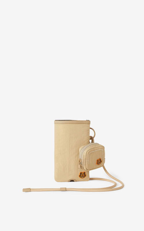 BEIGE Tiger Crest phone and headphones holder with strap for unisex KENZO